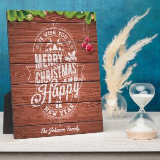 Entwurf der frohen Weihnachten und des guten Fotoplatte