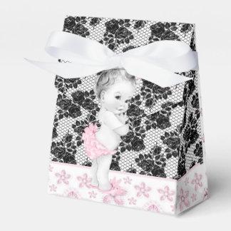 Entzückende rosa und schwarze geschenkkartons