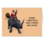 Équitation du père noël sur le rhinocéros cartes de vœux