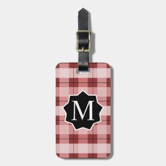 Étiquette rouge de baril de plaid décoré d'un étiquette à bagage