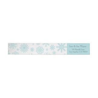 Étiquettes blancs bleus de Noël de flocon de neige