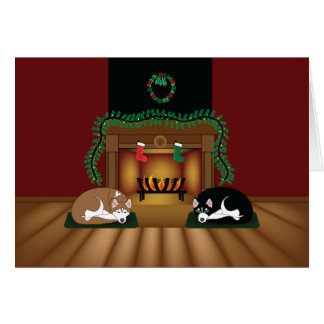 Feiertags-Huskies, der durch die Kamin-Karte Grußkarte