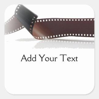 Film-Streifen mit Reflexion auf Weiß Quadrat-Aufkleber