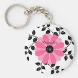 Fleur rose et noire décorée d'un monogramme à la m porte-clés