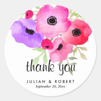 Fleurs lunatiques d'aquarelle épousant le Merci Sticker Rond