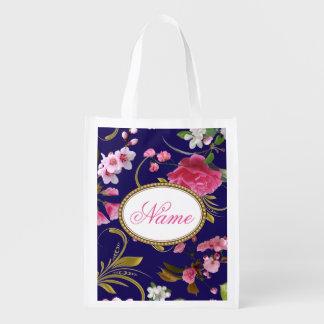 Fleurs roses de monogramme sacs d'épicerie
