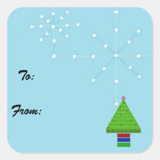 Flocons de neige et un arbre lunatique autocollant carré