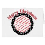 Flocons de neige sur le cadre noir de photo d'arri cartes de vœux