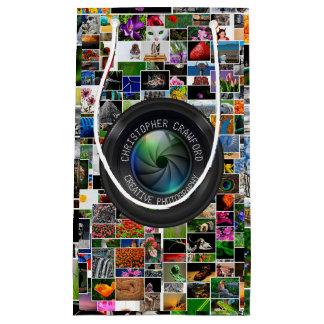 Fotograf und Fotografie-Geschäfts-Kameraobjektiv Kleine Geschenktüte