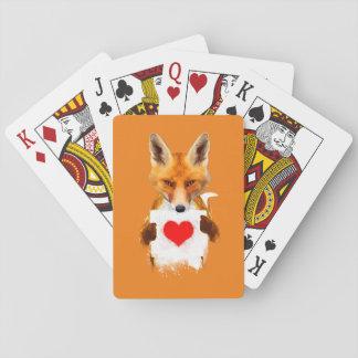 Fox, der Spielkarten eines Herzens hält