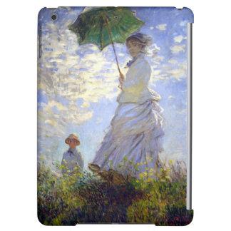 Frau mit einem Sonnenschirm durch Claude Monet