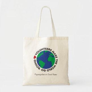 Freiwillige lassen die Welt gehen 'rund mit Erde Tragetasche