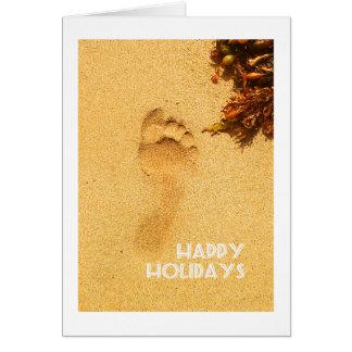 Frohe Feiertage Abdruck im Strandsand Karte