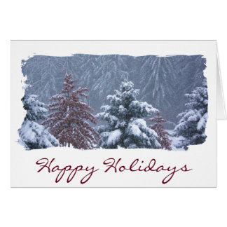 Frohe Feiertage schneebedeckte bequeme Karte