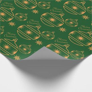 Frohe Weihnacht-Verzierungen auf Grün Geschenkpapier