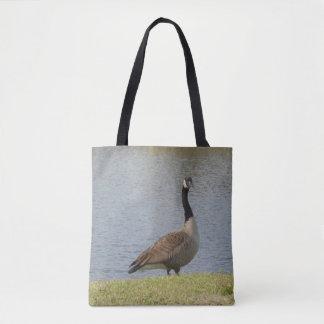 Gans durch Teich-Tasche Tasche