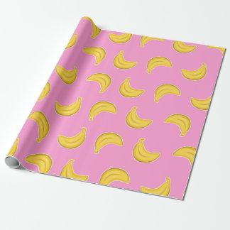 Gehende Bananen im Rosa Geschenkpapier