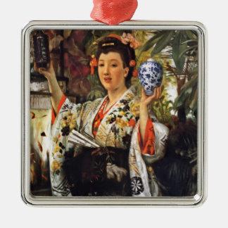 Geisha-Mädchen, das Ingwer-Glas hält Silbernes Ornament