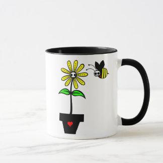 Geist-Gänseblümchen mit der Geist-Bienen-Tasse Tasse