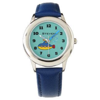 Gelbes und blaues Spielzeug-Unterseeboot mit Armbanduhr