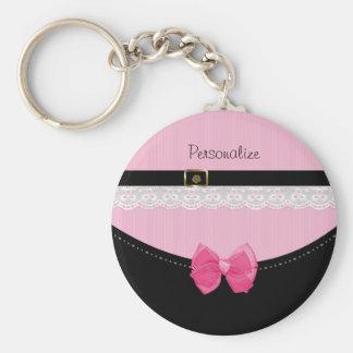Girly rosa und schwarze Babyschuhe mit Bogen und Schlüsselanhänger