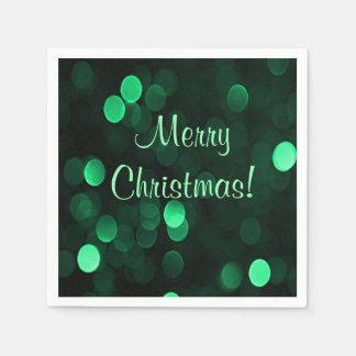 Glänzende grüne Weihnachtslichter Bokeh frohe Papierservietten