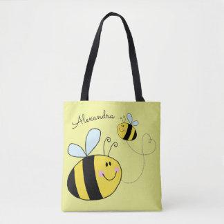 Glückliche Hummel-Bienen, die das Herz Tasche