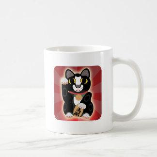 Glückliche Smokings-Katze zu Hause Kaffeetasse