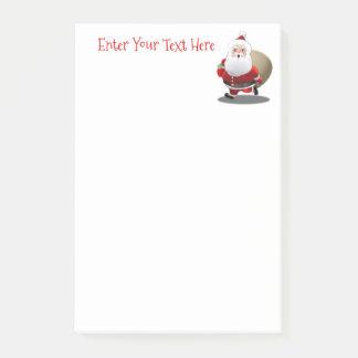 Glücklicher Weihnachtsmann mit einem Sack voll von Post-it Klebezettel