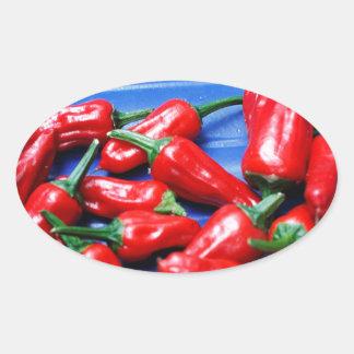 Glühend und Blau: Paprika-Paprikaschoten Ovaler Aufkleber