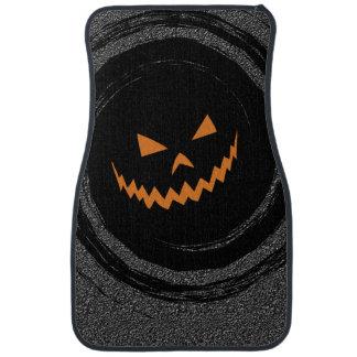 Glühender Jack O'Lantern Halloweens in einem Automatte