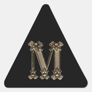 Goldenes Foto des Buchstabe-M auf schwarzem Dreiecks-Aufkleber