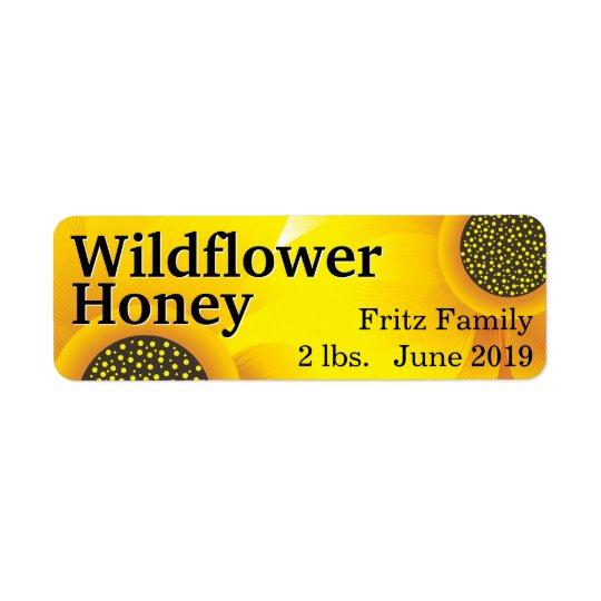 Goldenes Wildblume-Honig-Glas