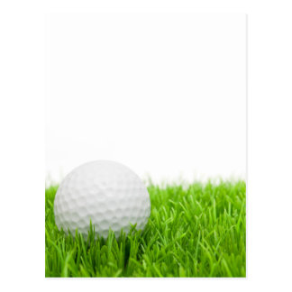 Golfball im Gras Postkarte