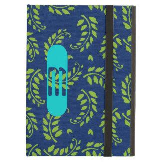 Grünen Sie auf blauem Blätter mit Aqua-Monogramm