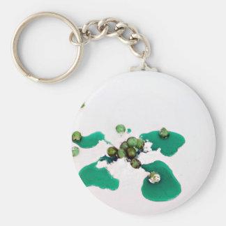 Grüner kandierter Kirschsirup auf Puderzucker Schlüsselanhänger