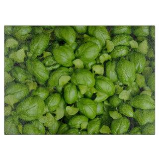 Grünes Basilikum-Blätter Schneidebrett