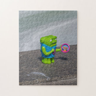Grünes Plastikspielzeug-Fotopuzzlespiel
