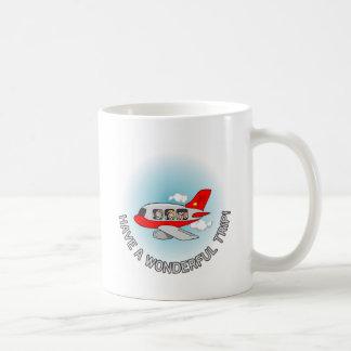 Haben Sie eine wunderbare Reise! Flugzeug mit Kaffeetasse