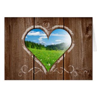 Herz-Knoten in der Zaun-Valentinstag-Karte Grußkarte
