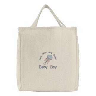 Hochet de bébé - bleu sac brodé