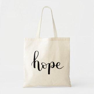 Hoffnungs-Handmit buchstaben gekennzeichnete Tragetasche