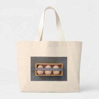 Hölzerne Eier in einem Kasten Jumbo Stoffbeutel