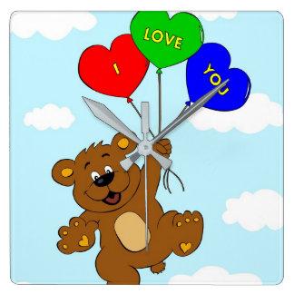 Horloge Carrée Ours avec des ballons dans des enfants de bande