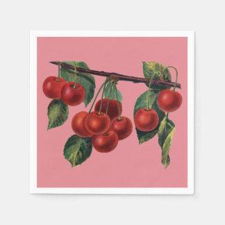 Hübsche rote Kirschen auf Papierserviette
