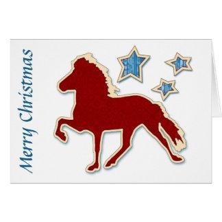 Isländisches Pferd spielt frohe Weihnachten die Karte