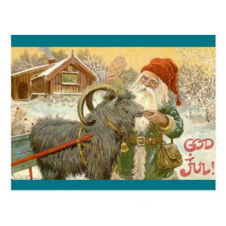 Jultomten füttert Weihnachten-Ziege ein Plätzchen Postkarte