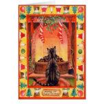 Katze, die durch den Kamin auf Weihnachtsabend sit Karten