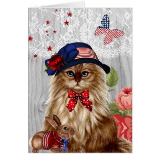 Katze kleidete im roten weißen und blauen karte