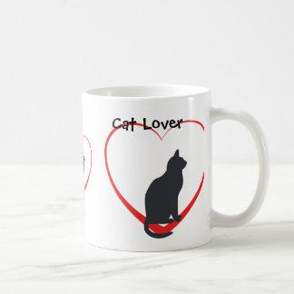 Katzenliebhaber, schwarze Katzen in den offenen Kaffeetasse